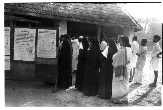 Ph.Studio/March,1957,A31a/A37d 1957 GENERAL ELECTIONS: A queue of women, including nuns, standing in a queue at a polling booth to cast their votes.