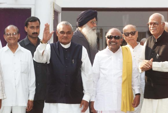 Indian Prime Minister Atal Behari Vajpayee (3rd L) waves during a photo session before the start of a National Democratic Alliance (NDA) meeting at his residence in New Delhi, October 8. In the picture (L-R) are Sukhram of the Himachal Vikas Congress, a security official, Vajpayee, Prakash Singh Badal, chief minister of Punjab state and leader of the Akali Dal, Muthuvel Karunanidhi, chief minister of Tamil Nadu state and leader of the dravida Munnetra Kazhagham, Khushabhau Thakre, president of the Bharatiya Janata Party (BJP) and Home Minister Lal Krishna Advani of BJP. The BJP-led NDA has won a majority in india's elections and is expected to form the next government. SM/HB - RTRRCUF