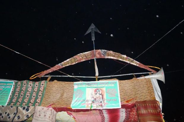 Posters with the traditional bow and arrow atop on a handmade tent