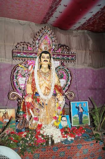 A statue of Mahisasura with a picture of B. R. Ambedkar