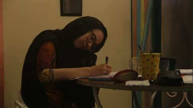 An Arabic woman sitting in a Kolkata café. I remember the sound of her incessant scribbling.